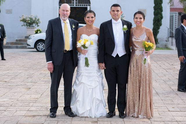 writer standing with her family at wedding