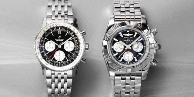 two silver breitling watches