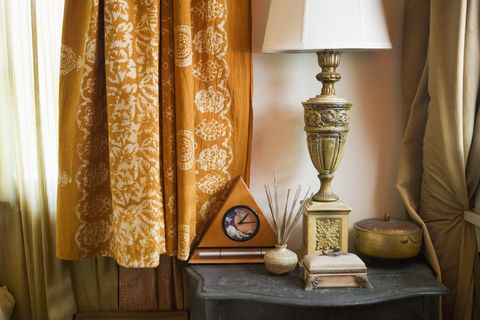Eclectic Side Table with Lamp and Clock