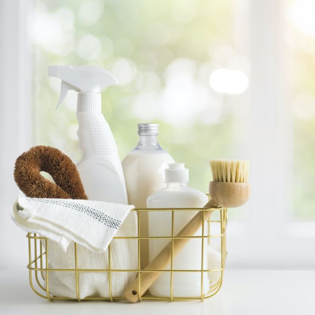 eco friendly natural cleaning products on table and window background
