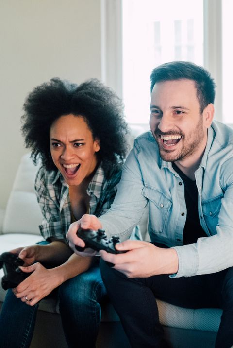 ecstatic young couple playing video games