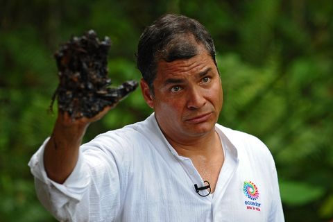 ecuadorean president rafael correa shows his oil covered hand at aguarico 4 oil well in aguarico, ecuador on september 17, 2013 aguarico 4 was operated by us oil company texaco between 1962 and 1990 correa called tuesday for a global boycott of chevron, as part of a campaign to highlight amazon environmental damage ecuador attributed to the us oil giant chevron has never worked directly in ecuador but inherited a pollution lawsuit when it acquired texaco in 2001, and has yet to pay an associated fine  afp photo  rodrigo buendia        photo credit should read rodrigo buendiaafp via getty images
