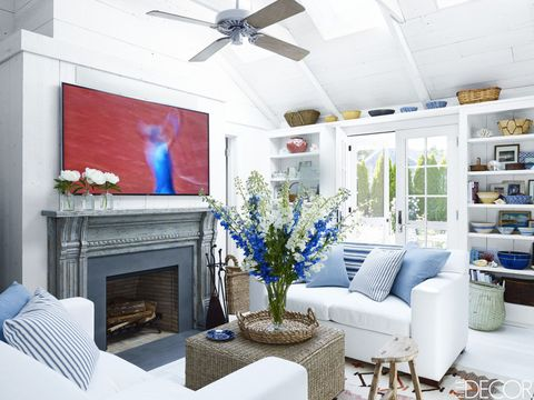 Living room, Room, White, Blue, Furniture, Property, Interior design, Ceiling fan, Mechanical fan, Ceiling,
