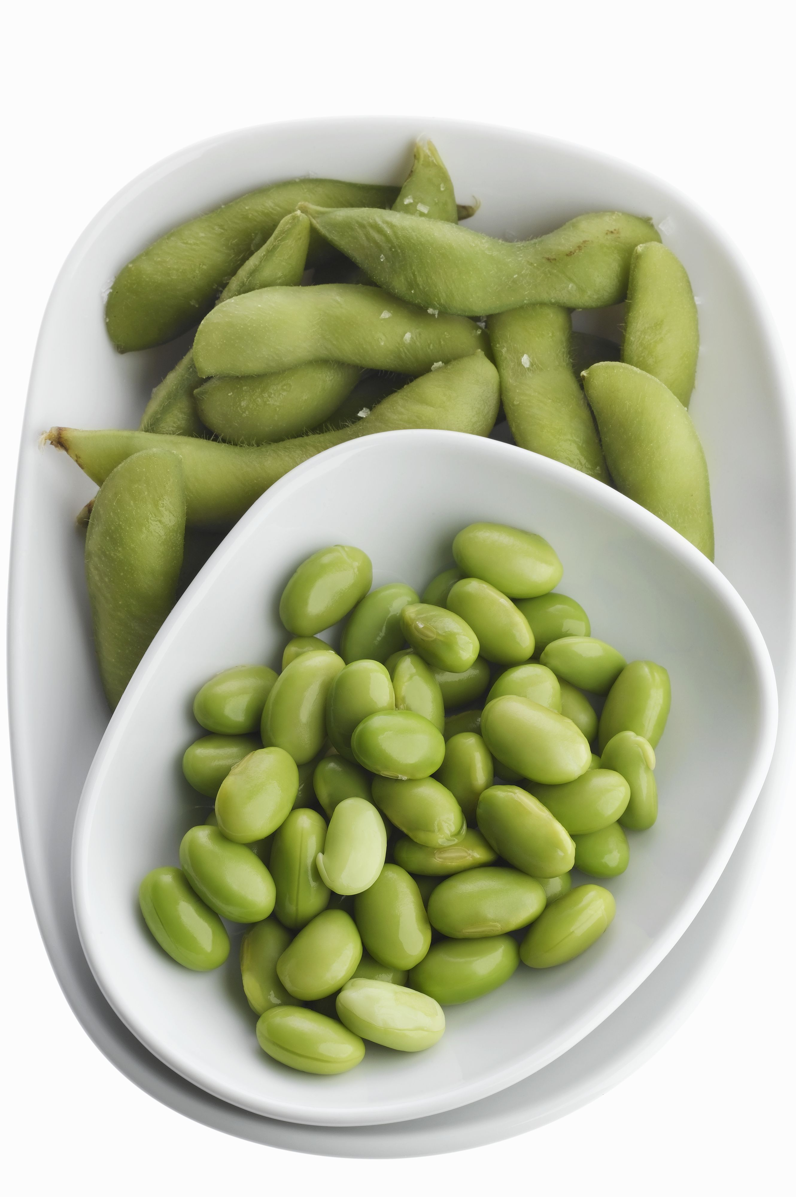 Edamame in bowl with chopsticks, overhead view