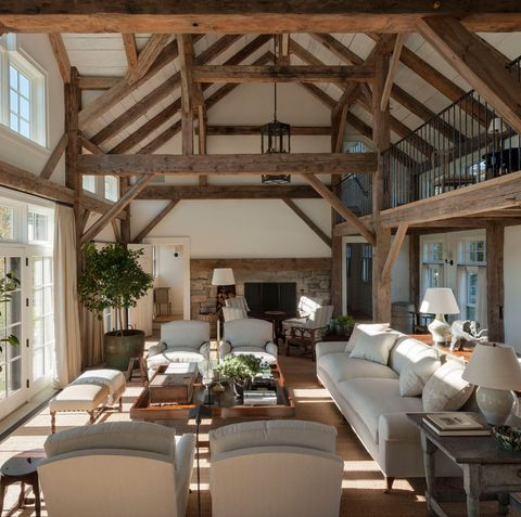 living room with high wood beamed ceiling