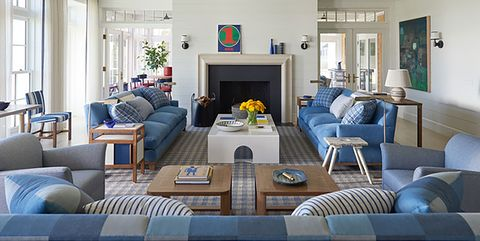 room with blue sofas