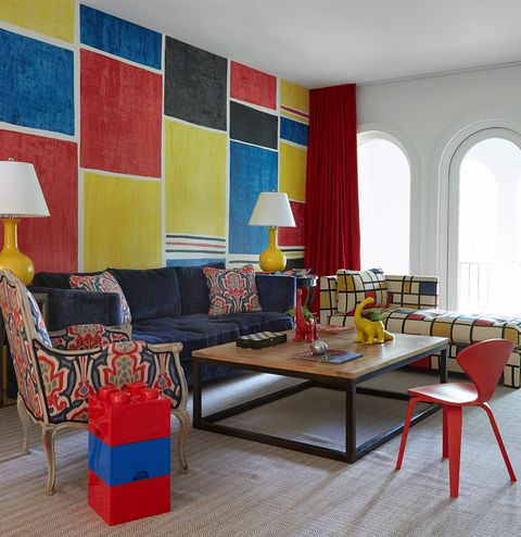 Living room, Room, Furniture, Interior design, Red, Yellow, Coffee table, Blue, Table, Wall,