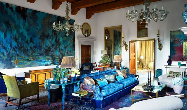 living room with blue sofa and table and large painting