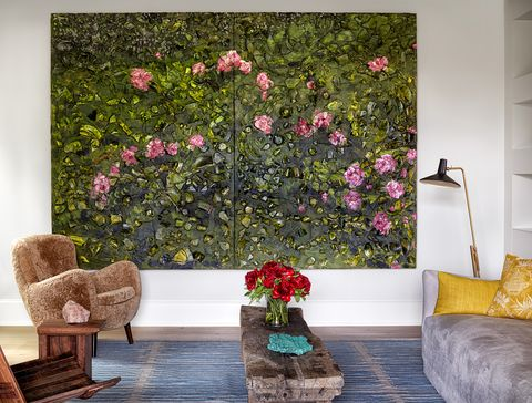 large floral painting between chair, bench and sofa