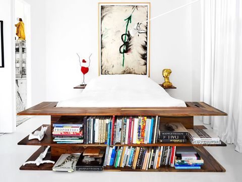 bed with build in shelves as the frame