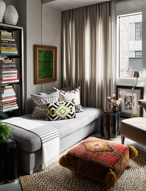 Corner of room with chaise and Turkish poof as table