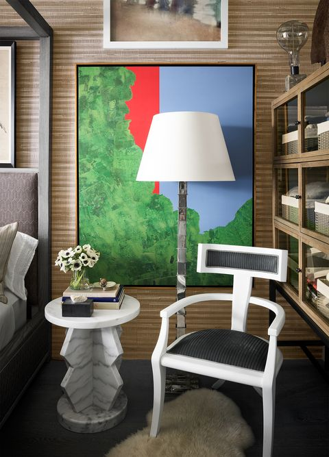 white geometric chair and table with artwork behind