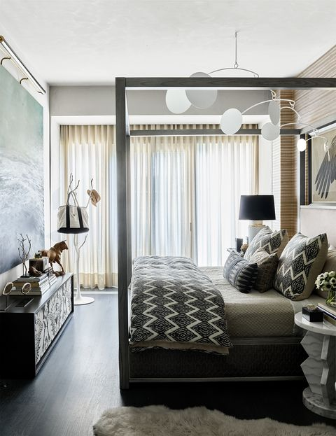 four-poster bed with black-and-white zigzagged linens