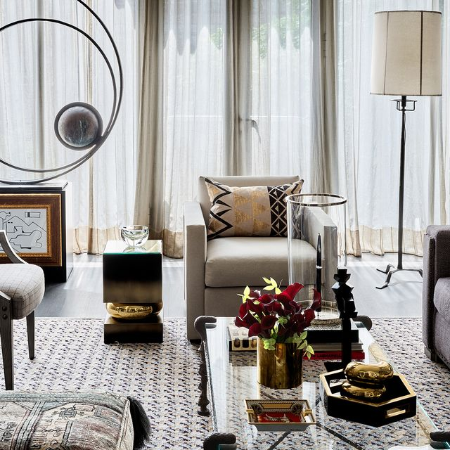 Living room, Room, Furniture, Interior design, Couch, Coffee table, Table, Curtain, Wall, Black-and-white,