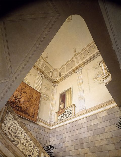 large vaulted stair hall with painted stone blocks