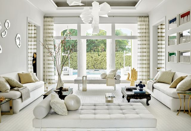 aman and meeks living room with white furniture and large doors