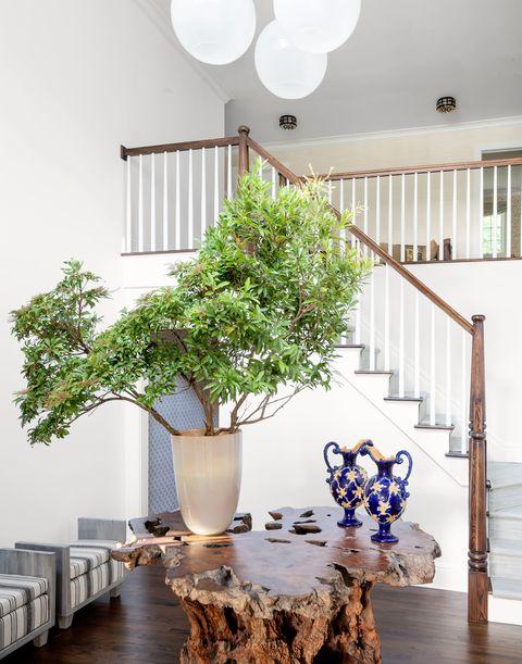james huniford rustic table in stairway hall