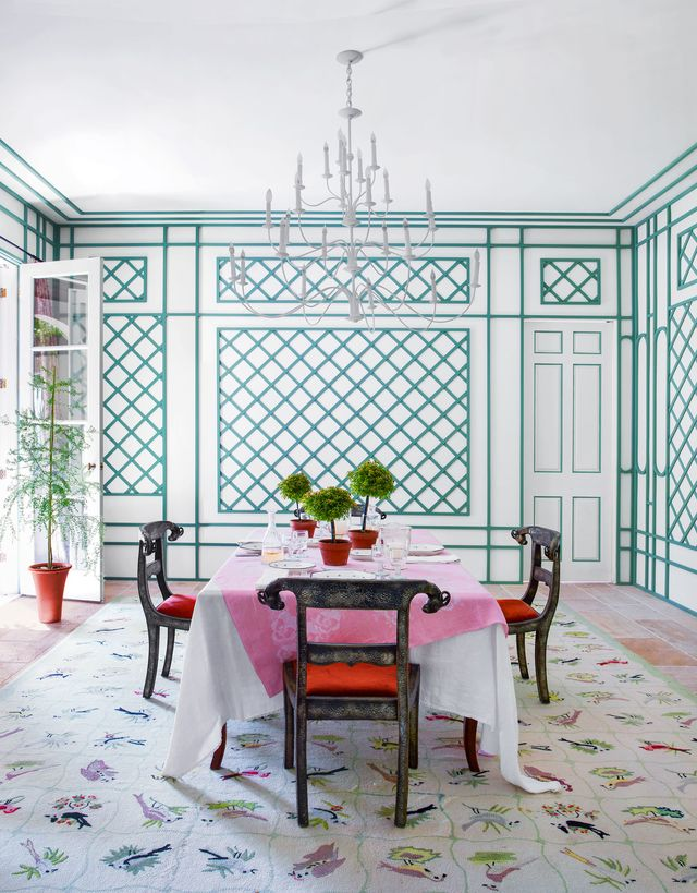 dining room with latticework walls and botanical rug