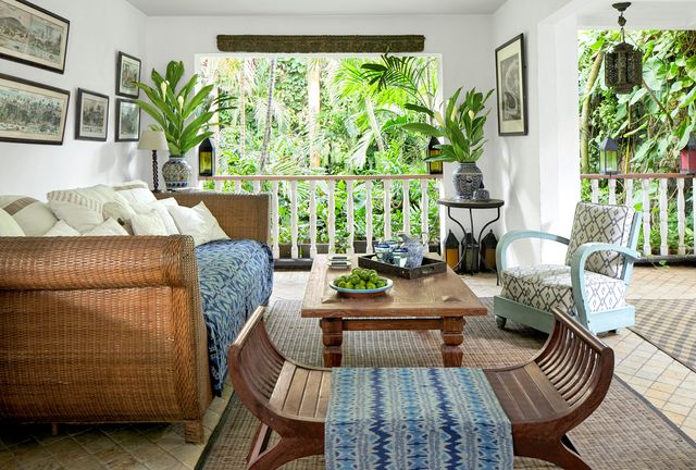 sitting area with rattan sofa overlooking the garden