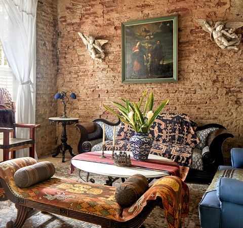 living area with brick wall and angel sconces