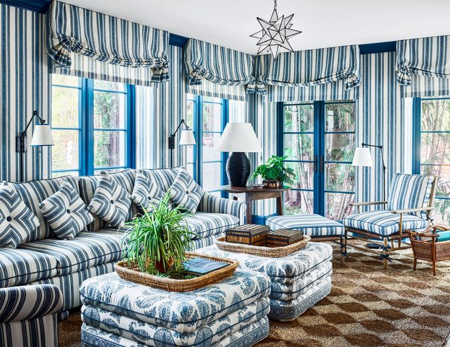 blue patterned living room with sofa and large ottomans