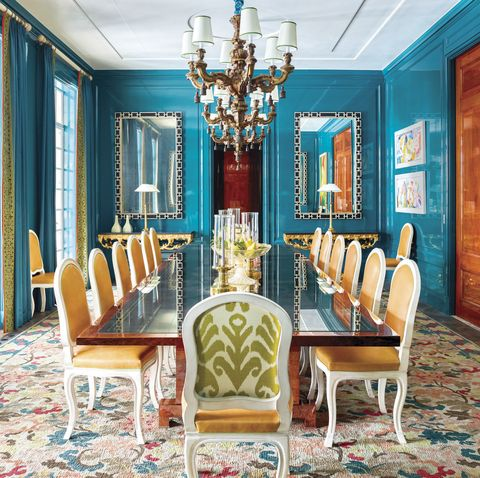 dining room with blue walls and flowered carpet
