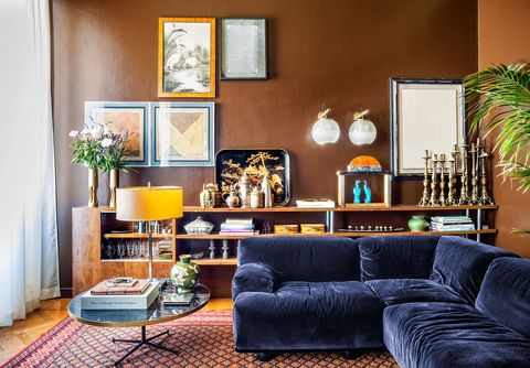 living room with blue sofa and antique candlesticks behind