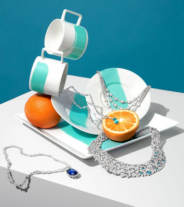 tiffany diamond necklace on a blue and white coffee set