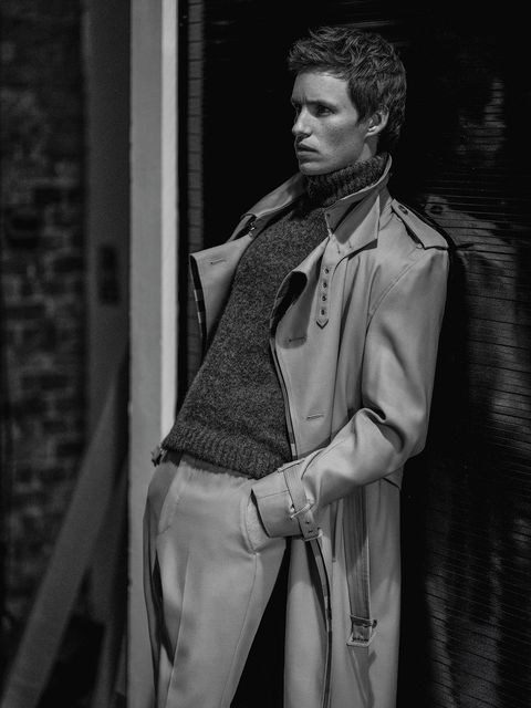 the actor eddie redmayne, star of the film the chicago 7 trial on netflix, poses for the magazine esquire spain with ami's sweater and burberry trench coat and pants