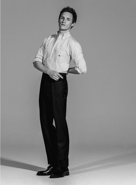 actor eddie redmayne, star of the film the chicago 7 trial on netflix, poses for esquire spain magazine with etro shirt, prada pants and boss shoes