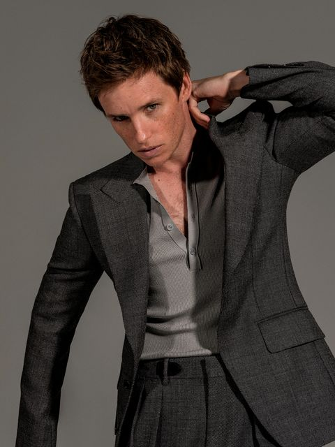 actor eddie redmayne, star of the film the chicago 7 trial on netflix, poses for esquire spain magazine with a tom ford jersey and suit