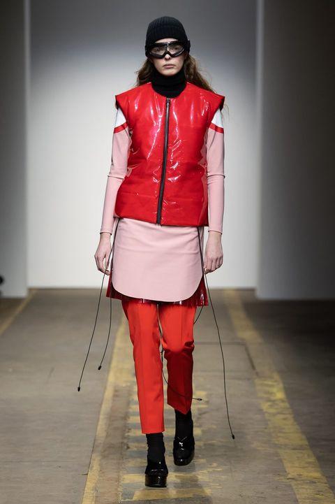 Fashion, Runway, Fashion model, Red, Fashion show, Clothing, Fashion design, Jacket, Footwear, Leather,