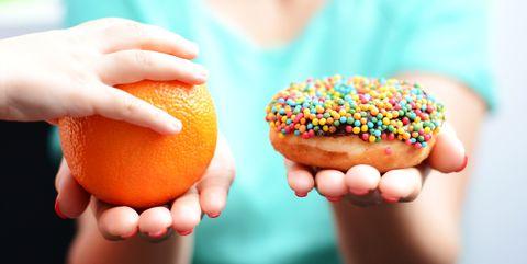 Food, Sprinkles, Orange, Sweetness, Beschuit met muisjes, Cuisine, Nonpareils, Hand, Baked goods, Doughnut,