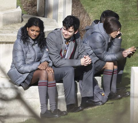 actors simone ashley and asa butterfield on the set tv show 'sex education' in kent
