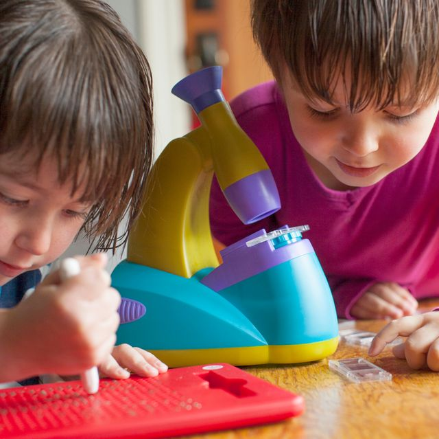 kids playing with toy microscope