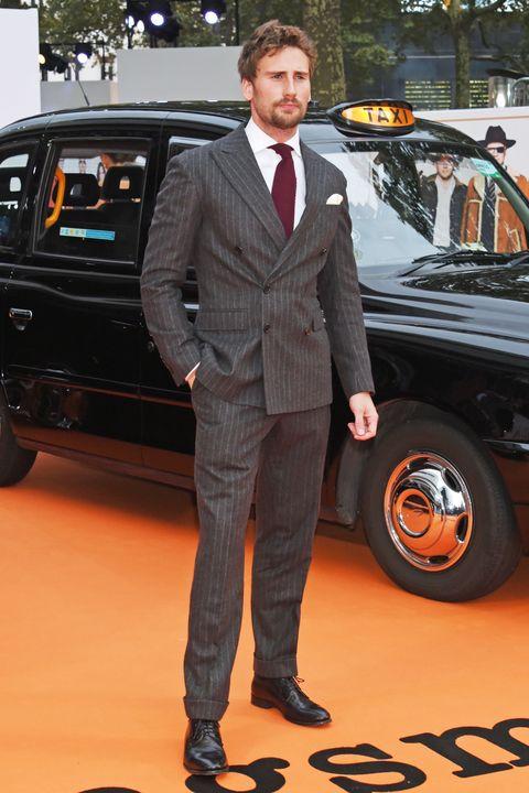 Vehicle, Car, Suit, Automotive design, Luxury vehicle, Formal wear, Auto show, Premiere,