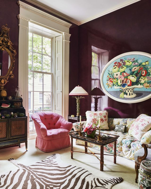 the aubergine living room is part of the familys private quarters and it has a glazed wall finish and zebra pattern rug