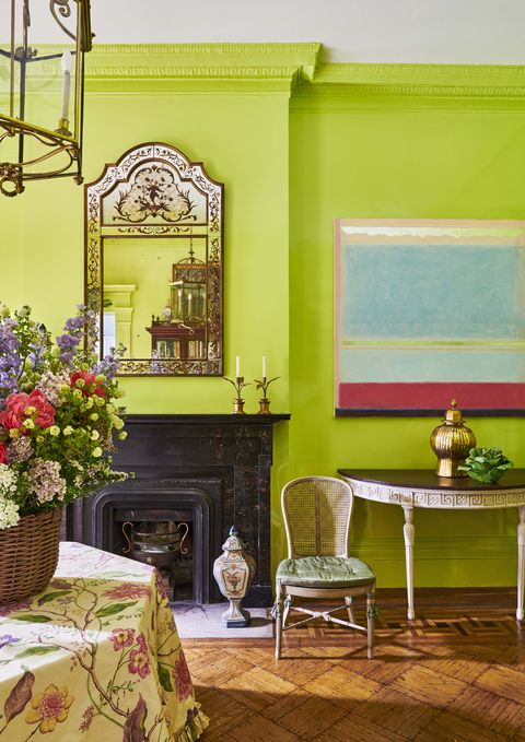 a 20th century chinoiserie mirror and contemporary oil painting by margaret kennedy shine atop lime green walls