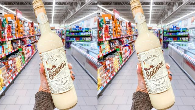 hand holding a bottle of eggnog in an aldi store