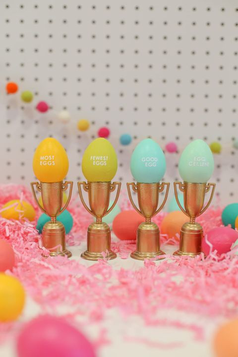 gold trophies with multi colored easter eggs on top