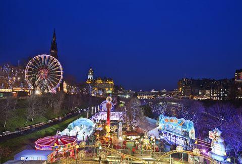 Ferris wheel, Landmark, Night, Tourist attraction, Urban area, Amusement park, Metropolitan area, City, Sky, Amusement ride,