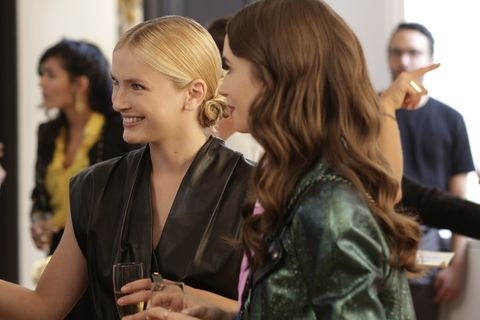 emily in paris l to r camille razat as camille and lily collins as emily in episode 104 of emily in paris cr carole bethuelnetflix © 2020