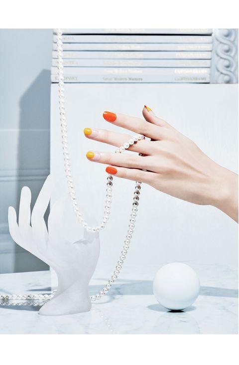Orange, Hand, Finger, Fashion accessory, Jewellery, Nail, Ear, Glass, Pearl,