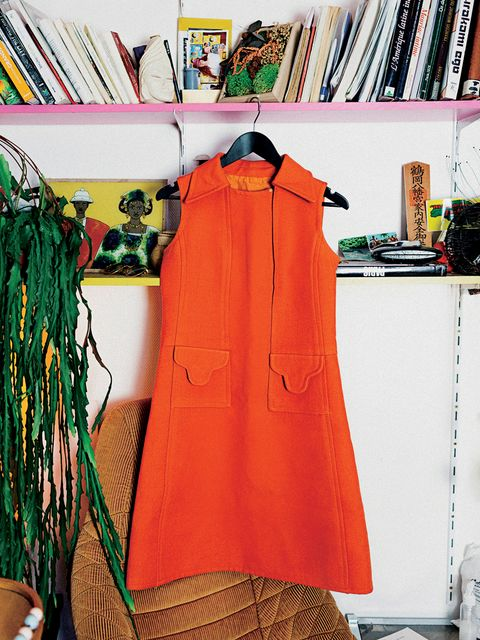 Clothing, Clothes hanger, Orange, Outerwear, Room, Peach, Dress, Fashion design, Sleeveless shirt,