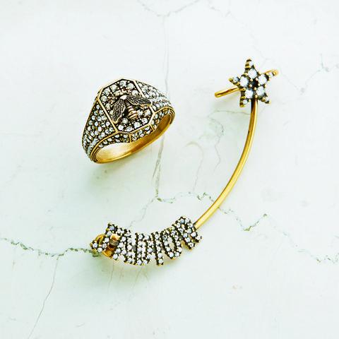 Fashion accessory, Body jewelry, Jewellery, Brooch, Metal, Gold,