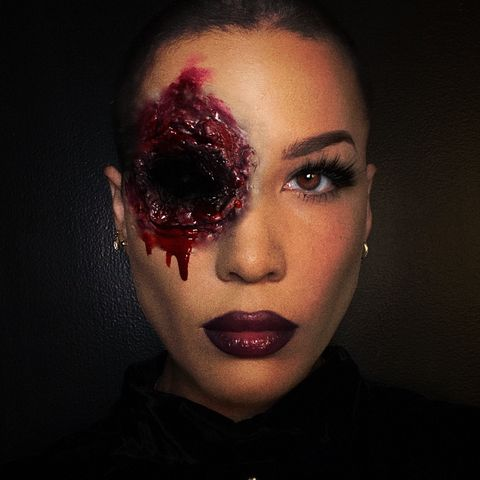 halsey in makeup that shows a bloody eye socket
