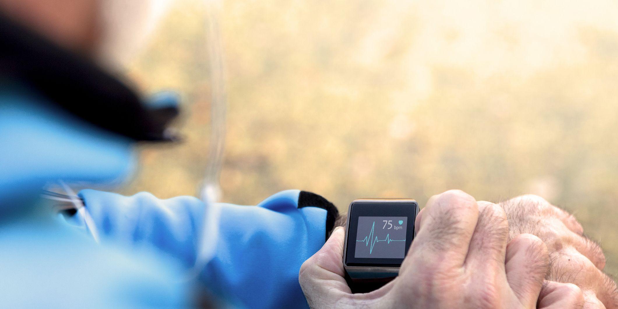 Elderly Man using Smart Watch measuring heart rate