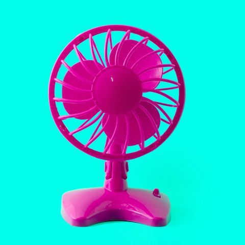 electric retro plastic fan isolated on pastel background