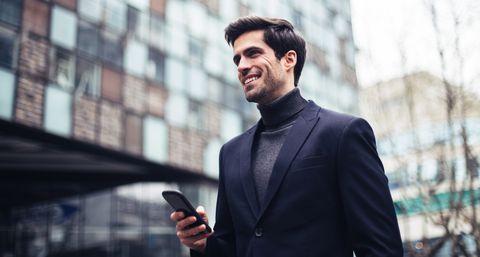 Elegant male using mobile