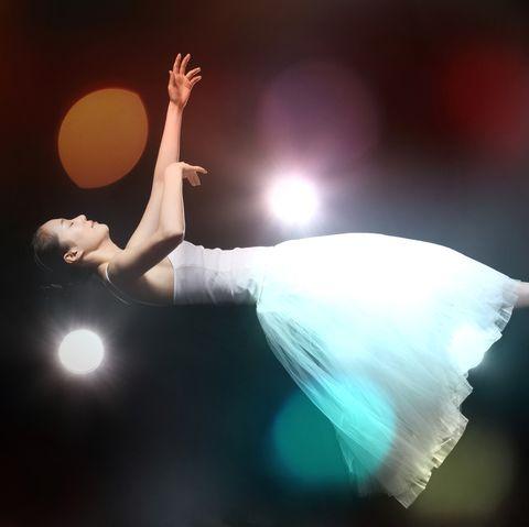 Elegant Woman In Mid-Air